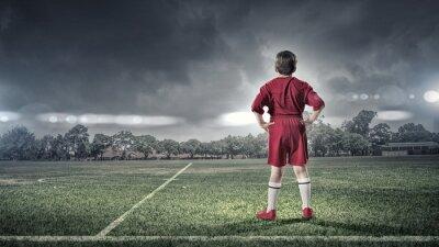 Quadro bambino ragazzo sul campo di calcio