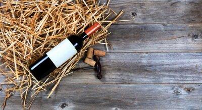 Quadro Bottiglia di vino rosso con cavatappi vino d'annata sulla paglia