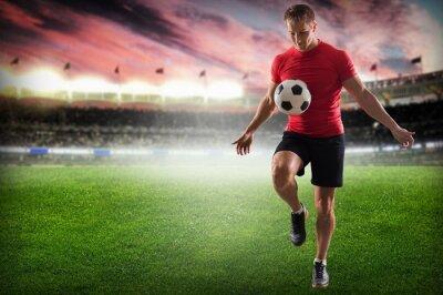 Quadro Calcio. Calciatore professionista calci palla