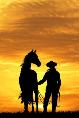 Quadro cowboy con il cavallo al tramonto