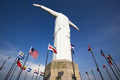 Quadro Cristo del Rey statue of Cali with world flags and blue sky, Col