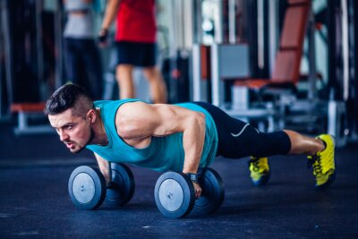 Quadro Crossfit instructor at the gym doing pushups