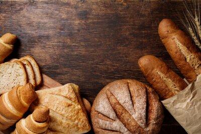 Quadro Different bread on a rustic dark background
