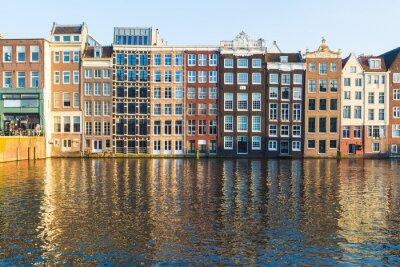 Quadro Edifici lungo il Damrak durante il giorno ad Amsterdam