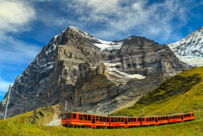 Quadro Famous electric red tourist train coming down from the Jungfraujoch station(top of Europe) in Kleine Scheidegg,Bernese Oberland,Switzerland,Europe