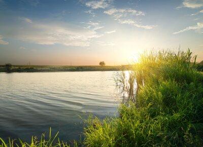 Quadro fiume tranquillo al tramonto