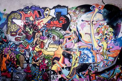 Quadro Fond mur de graffitis aux couleurs vives