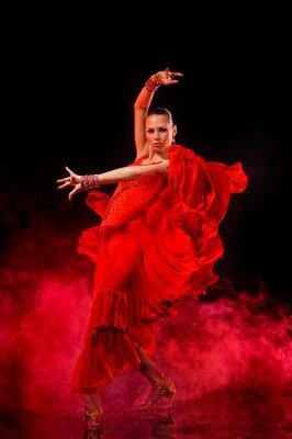 Quadro Giovane donna ballare Latino su sfondo fumoso scuro
