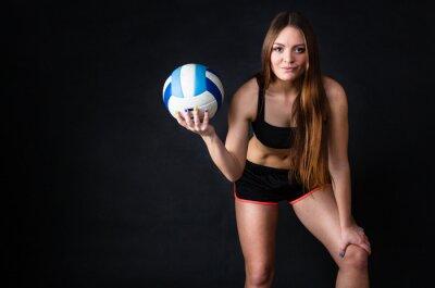 Quadro Giovane ragazza in possesso di pallavolo su sfondo nero