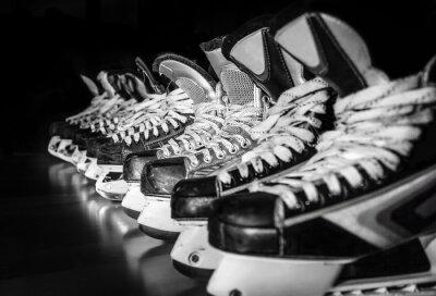 Quadro Hockey skates lined up in locker room