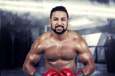 Quadro Immagine composita di uomo muscolare boxe in guanti