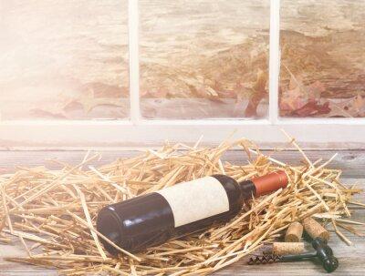 Quadro luce Finestra sul bottiglia di vino riposa in paglia