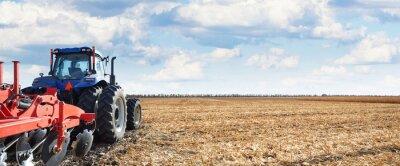 Quadro Macchine agricole lavorano nel campo