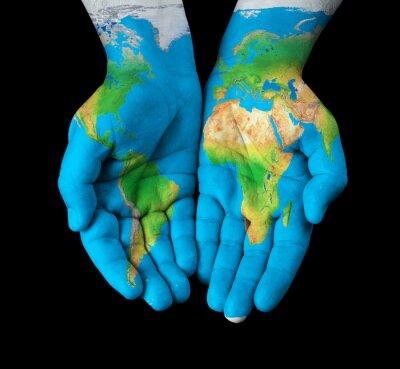 Quadro Mappa dipinto su mani mostrando concetto - il mondo nelle nostre mani
