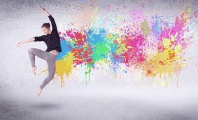 Quadro Moderna ballerino di strada saltando con spruzzi di vernice colorata