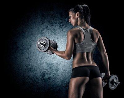 Quadro Muscular woman in studio on dark background