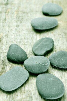 Quadro pietre su una superficie di legno vecchio