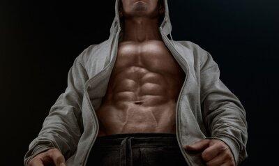 Quadro Primo piano su addominali perfetti. Forte bodybuilder con sei pack