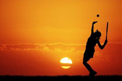 Quadro ragazza che gioca a tennis al tramonto
