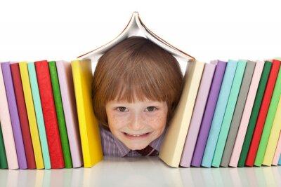 Quadro Ragazzo felice con coloratissimi libri