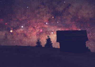 Quadro Sagome di un paesaggio con Via Lattea. Lunga esposizione foto scattata da un cima di una montagna scura.