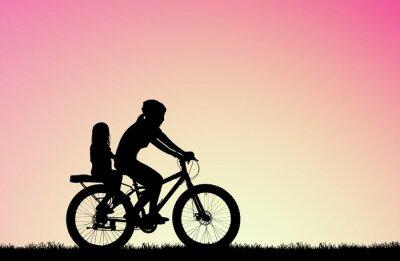 Quadro silhouette Madre va in bicicletta con la figlia all'alba sfocata