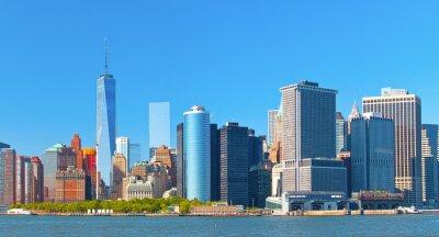 Quadro Skyline di edifici del distretto finanziario di New York Lower Manhattan Wall Street su una bella giornata estiva con cielo blu