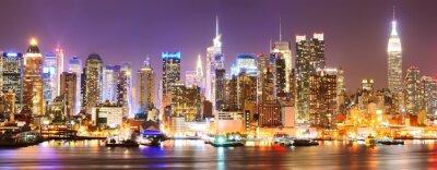Quadro Skyline di Manhattan durante la notte.