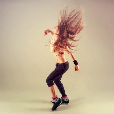 Quadro Studio shoot of active female funk jazz dancer moving.