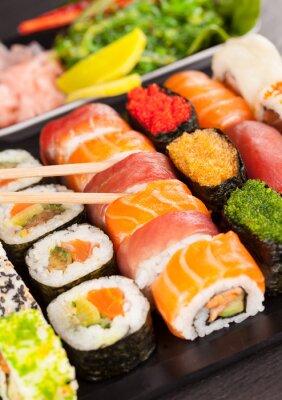 Quadro sushi pieces with chopsticks