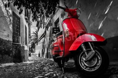Quadro Una vespa scooter rosso parcheggiato su una strada asfaltata