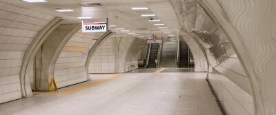 Quadro Underground subway station hallway tunnel with escalator. Abstract perspective view