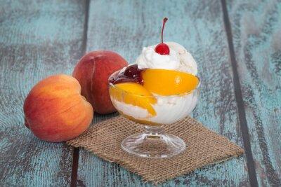 Quadro Vanilla peach melba ice cream with peach fruits on wooden vintag