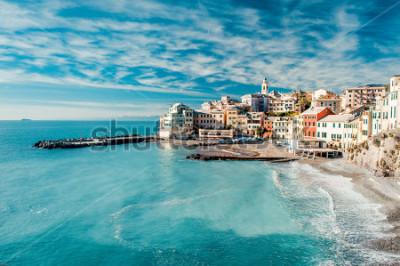 Quadro View of Bogliasco. Bogliasco is a ancient fishing village in Italy, Genoa, Liguria. Mediterranean Sea, sandy beach and architecture of Bogliasco town. Cloudy blue sky sunny day idyllic scenery, winter
