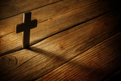 Quadro wooden cross on wood background